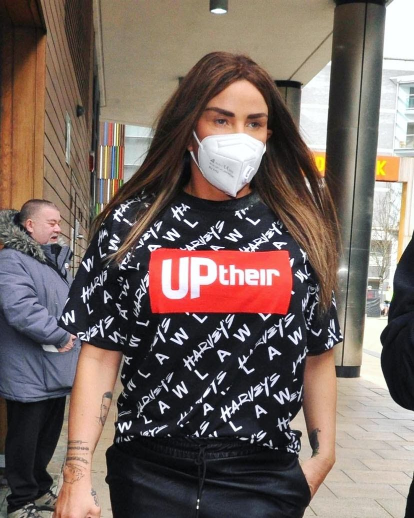 Katie Price with a mask on wearing an Uptheir t-shirt
